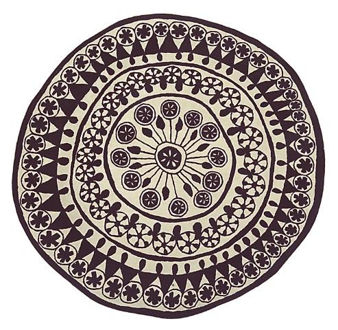 tappeti rotondi con motivi geometrici